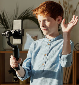 image of boy with smartphone